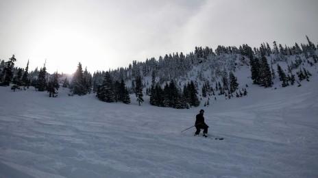A skier finds powder in Big Chief Bowl.