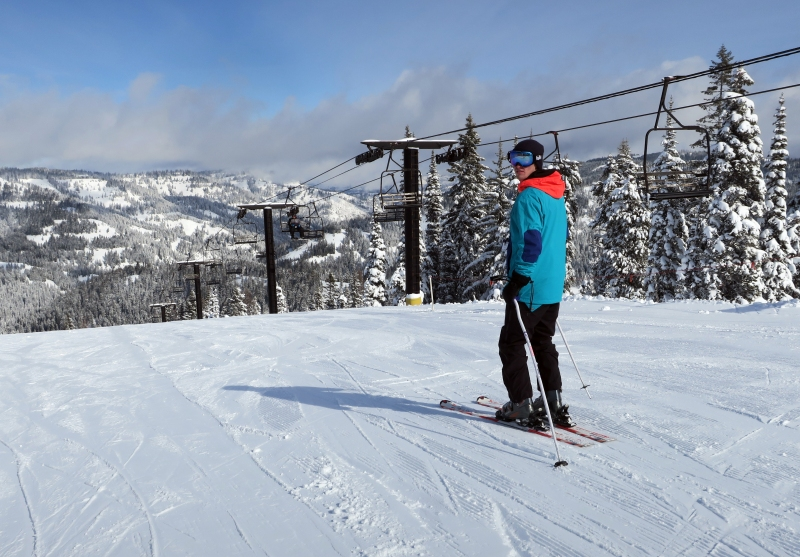 A skier heads down off of the top of Bluewood.