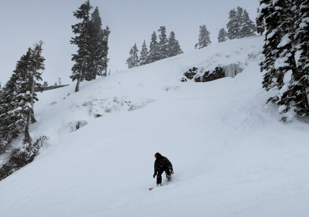 A boarder rides the lower slopes of Pan Face.