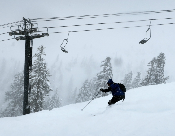 A skier shreds soft snow on Chair 6.